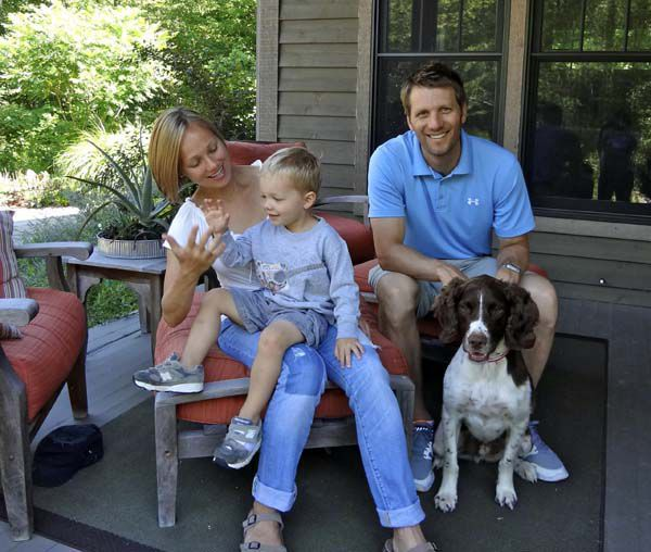The Golitko family -- Raygan, from left, three-year-old Grissom, Matt, and five-year-old Charlie -- enjoy a dog-friendly vacation together in Michigan.