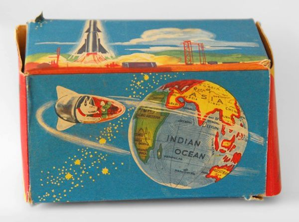 Toy packaging with Laika's image on it, happily orbiting the earth.