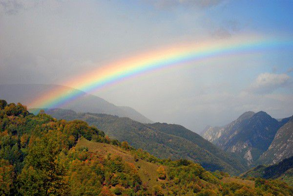 Rainbow with Mountains via Shutterstock