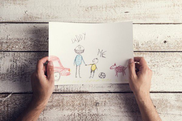 Younger kids can't write grief letters, but they can draw their memories. (Child's Drawing by Shutterstock)