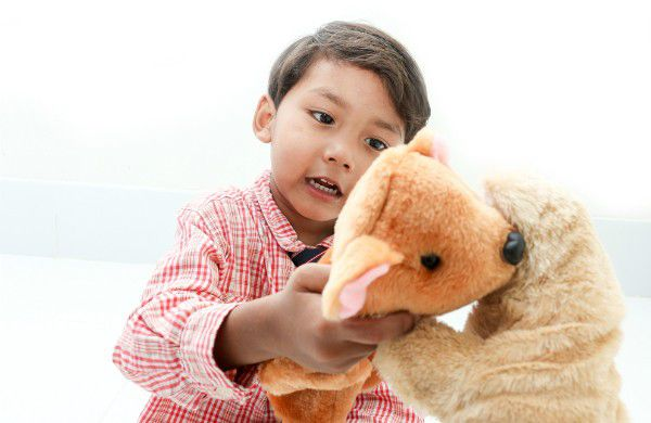 Puppets can help kids say goodbye to a departed pet. (Child and Puppets by Shutterstock)