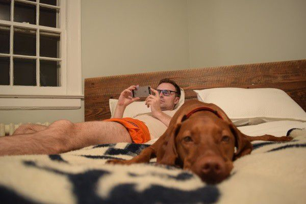 My husband and Finley definitely trust and respect each other, and maybe sharing a bed has something to do with it. (Photo by Whitney C. Harris)