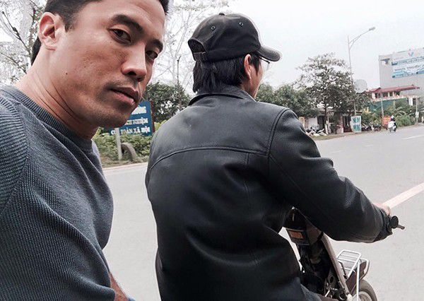 Marc on the back of his translator's moped in Hanoi, following a near-death experience at a slaughterhouse. Photo courtesy of Marc Ching.