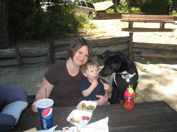 Riggins tries to find a way to steal my nephew's fries while my sister is busy smiling for the camera. (Photo by Wendy Newell)