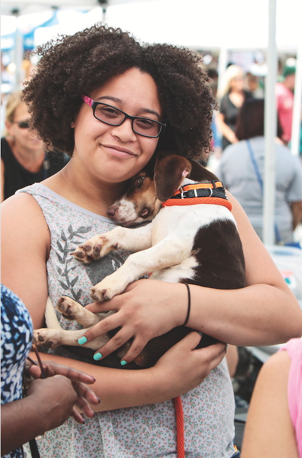 Woman volunteering with animals by iStock.