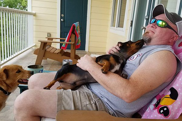 """""""Michael and his dogs"""" -Submitted by Facebook user Cora Turner"""